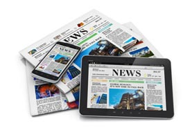 Collage of newspapers shown in both print and on electronic devices.