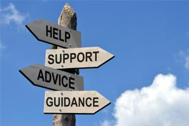 "Image of signpost with four signs pointing in different directions. The four signs say ""help,"" ""support,"" ""advice"" and ""guidance."""